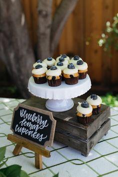 Baby Shower Cake Blueberry lemon cupcakes from a Rustic Lemon Themed Baby Shower on Kara's Party … Baby Shower Drinks, Baby Shower Desserts, Baby Shower Signs, Baby Shower Cupcakes, Shower Cakes, Baby Shower Parties, Baby Shower Themes, Baby Boy Shower, Shower Ideas