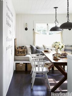 A banquette, with storage underneath, doubles as a guest bed.