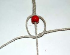 making a knot under the bead