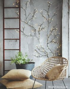 Roost Twinkling Willow Wall Lights are flexible wire construction allows for infinite variation. Tiny bulbs at the end of floral-tape-wrapped wire illuminate brightly when the branches are plugged in. These completely customizable branches are available in two sizes.