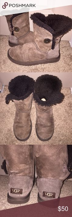 Bailey Button UGGs Authentic chocolate brown bailey button style UGGs. Lightly worn and still has plenty of life left in them!! UGG Shoes Winter & Rain Boots
