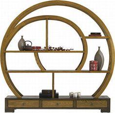 A magnificent wooden ellipse bookcase by La Maison Coloniale.