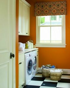I like the built in cabnits over the washer and dryer.  Would do more earth tone paint and crurtian