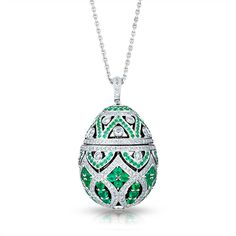 Faberge Zenya Emerald Egg Pendant -  One of a small capsule collection of opulent gem-set egg lockets, each one of a kind and designed to echo the graphic patterns of traditional Uzbek textiles. This Zénya egg locket in white gold is composed of stylised cupolas and set with white diamonds, creating a striking rhythmic design. - This piece is set in 18 carat white gold and features emeralds and white round diamonds.