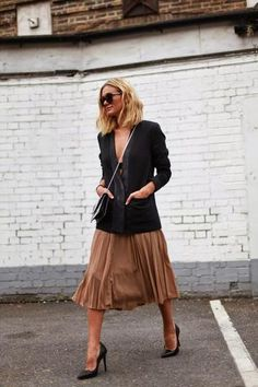 Knee-length camel pleated skirt, black blazer + low cut top and pointy-toe heels