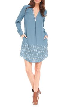 "Get the perfectly flowing relaxed-fit shirt dress, complete with practical pockets. This show-stopping dress also comes with eye-catching details such as embroidered arrows and an open mandarin collar. Belt this dress at the waist for a more tailored fit. Features: Teal with embroidered arrow pattern V-neck Relaxed flowy silhouette Fully lined Wear it loose or with a belt Practical pockets Curved shirt tail hem with side slits    Measurements: length: size small 37.5"" (from high point…"