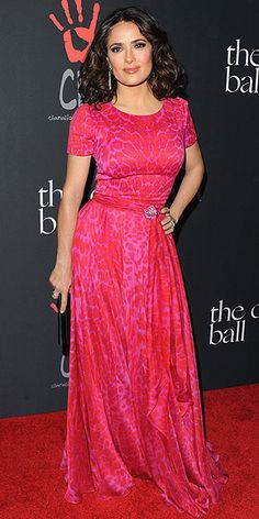Red and pink leopard print could seem like a lot for a fancy event, but Salma's impeccably tailored and draped gown at ...