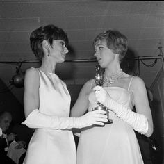 Audrey Hepburn and Julie Andrews photographed at the 1965 Academy Awards