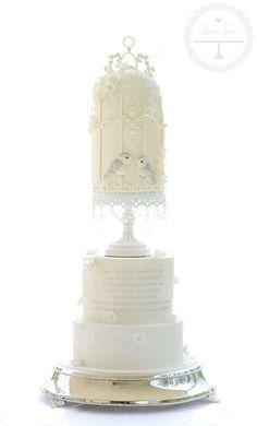Stunning white on ivory birdcage wedding cake