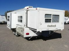 Here's the expandable Keystone Outback TT25RSS travel trailer.