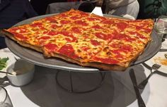 Umberto's Pizzeria & Restaurant in New Hyde Park, NY (Grandma Pie -- 16 inch by 16 inch square, 12 slices, think-crust pie topped with mozzarella and plum marinara sauce)