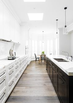 White Shaker Cabinets Galley Kitchen calcatta oro marble counters and backsplash | biasol design studio