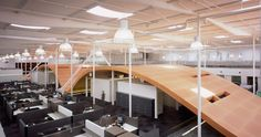 Redbull North America Headquarters by HLW. Event space, screening room, mezzanine, indoor skate ramp. Waves create seating areas, event spaces, cafes, etc