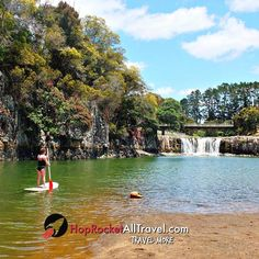 Paddleboarding, Haruru Falls, NZ.   Wanna Save on Travel?   #travel #travelmore #familytravel #vacation #trip
