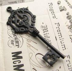 Large antiqued brass skeleton key pendant