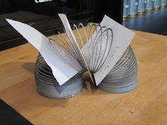 """Use a slinky to create clever storage for all those """"to do"""" lists & notes."""