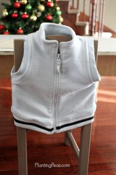 The zipping frame is one of many Montessori practical life activities. We discovered that draping a zippered vest, in his size, over the back of his chair,
