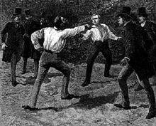"""Duel entre G. Boulanger et Charles Floquet, 13 juil 1888-  Georges Boulanger acquiert une grande popularité en prenant des mesures destinées à améliorer le sort de la troupe et en montrant une attitude énergique lors de l'incident franco-allemand d'avril 1887, ce qui lui vaut le surnom de """"général Revanche"""". En mai 1887, il est entraîné dans la chute du gouvernement Goblet, le ministère Rouvier est constitué sans Boulanger qui reçoit le commandement du 13° corps d'armée à Clermont-Ferrand."""