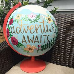 Hand painted globe with Adventure Awaits in metallic gold. This globe is completely hand painted with light blue covering the water and with a