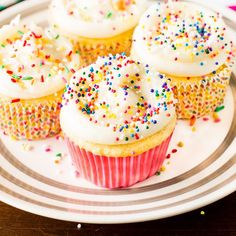 A recipe for Vanilla Cupcakes. My favorite Vanilla Cupcake recipe topped with vanilla buttercream frosting and sprinkles!