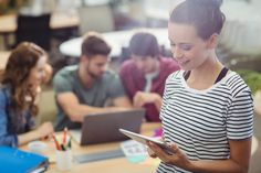 Female business executive using digital tablet Free Photo