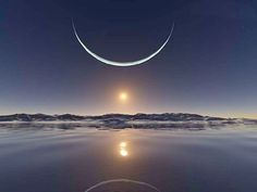 Sunset at the North Pole with the moon at its closest point, and shows the sun below the moon