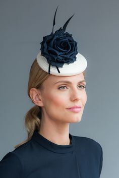 Kate: Straw cocktail hat with silk flower and arrowhead quills. Handcrafted in our London studio.