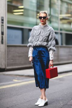 New Ways To Wear Clothes You Were About To Retire #refinery29 http://www.refinery29.com/unexpected-street-style-styling-tips#slide-9 Spruce up a chunky knit that's seen better days with a pretty lace top underneath and a fancier velvet skirt....