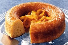 This traditional yeast cake, saturated in rum syrup, is filled with sweet caramelised oranges.