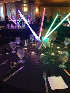 Light saber centerpieces turn into party favors later. #star_wars #barmitzvah: