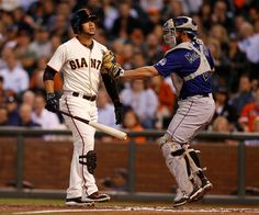 San Francisco Giants' Gregor Blanco (7) strikes out with two men on to end the second inning in front of Colorado Rockies catcher Michael McKenry (8) at AT&T Park in San Francisco, Calif., on Wednesday, Aug. 27, 2014.  (Nhat V. Meyer/Bay Area News Group)