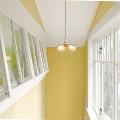 Windows added in this stairwell channel light inside and through awning-style interior windows in a child's bedroom