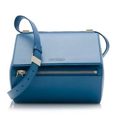 A classic Givenchy crossbody bag in textured blue leather with gold-tone hardware. Details include an adjustable strap, front pocket, flap closure, and fully lined interior with one zippered pocket.