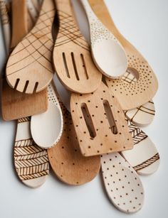 Etched Wooden Spoons... Mikes mom has a wood burner!! Could totally do this to boring cheap wooden spoons!!!
