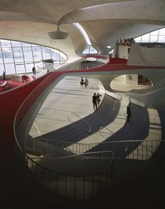 It may seem strange to want to go to an airport terminal, but Eero Saarinen's TWA terminal (now JetBlue) at JFK airport fascinates me with it's majestic sweeping beauty. http://en.wikipedia.org/wiki/TWA_Flight_Center