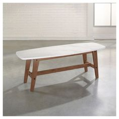 The Soft Modern Coffee Table features a Faux Carrara marble finish top with EverSheen® top-coat provides clear, durable finish that resists heat, stains, and scratches.  Finished on all sides for versatile placement. Ideal for living room or office. Fine Walnut finish.