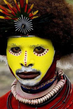 Papua New Guinea | Huli tribe wigman. New Guinea is the second largest island next to Greenland and is located in the Southwest Pacific Ocean.