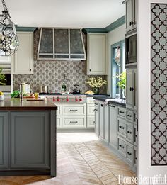 "When designer Annette English revamped a rabbit warren of rooms into an expansive kitchen, she built on the 1937 house's traditional style, then pushed it forward with eye-catching elements like faceted pendants from Reborn Antiques — ""big, but the transparency makes them feel light and airy,"" she says.   - HouseBeautiful.com"