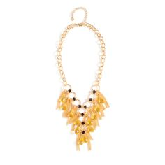Lula combines the on-trend vintage-inspired elements of chainmail and tassels with the shimmer of citrine stones and amethyst CZ's. Lula's gold adds an air of sophistication to this unusual piece.  $84