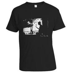 Black shirt with white print of Mat.