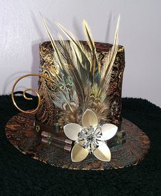 Timeless Tubes Steampunk mini Victorian top hat with chainmaille flower cherry blossom sakura. $33.00, via Etsy.
