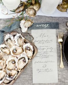 cool vancouver florist Celebrating by the sea. Black Pearl as seen in @wedluxe winter issue | photo by @nadiahungphotography | calligraphy by @writtenwordcalligraphy #wedluxe #menu #moderncalligraphy #pearl #luxe #bythesea by @chandelierwedding  #vancouverflorist #vancouverweddingstationery #vancouverflorist #vancouverwedding #vancouverweddingdosanddonts
