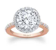 Barkev's rose and white gold halo engagement ring setting featuring a beautiful round diamond center.