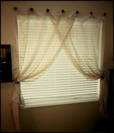 How To Hang a Curtain Without A Rod ... this would be good for the corner windows in our bedrooms