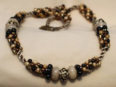 Beaded Kumihimo earth tones necklace with bronze toggle clasp on Etsy, $20.00