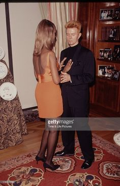 Singer and musician David Bowie with supermodel Iman, circa 1992.