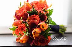 Wedding Flowers   Bridal Bouquets   Centerpieces   Flowers  #orangecallalily #orangeroses #orangetulips