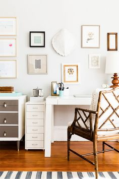 White office space with gallery wall and bamboo chair