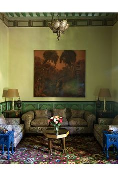 In the salon vert, a lacquer panel by Jean Dunand hangs above a seating area designed by Jacques Grange.
