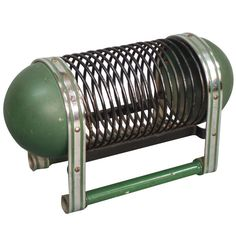 Machine Age Art Deco Chrome and Painted Steel Magazine Holder | From a unique collection of antique and modern magazine racks and stands at https://www.1stdibs.com/furniture/more-furniture-collectibles/magazine-racks-stands/